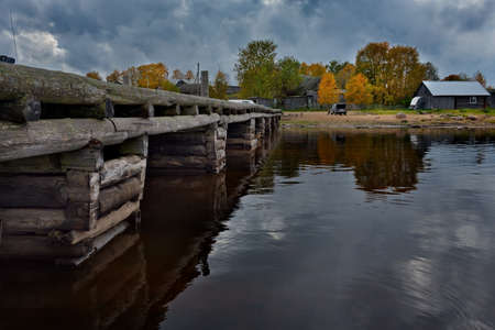Kuganavolok. Russia. October 03, 2018. An old wooden pier on the Vodlozero Lake in the village Republic of Karelia.
