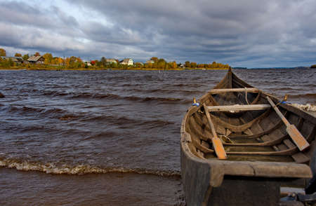 Russia. Republic of Karelia. Boat on the old wooden pier of Lake Vodlozero in the village of Kuganavolok.