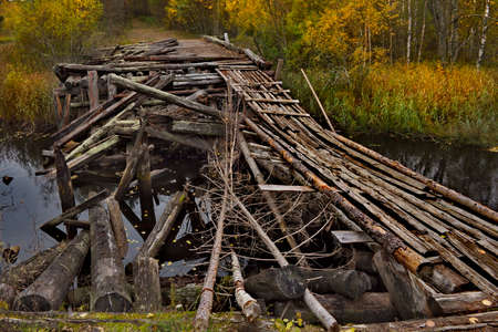 Russia. Republic of Karelia. A destroyed wooden automobile bridge on the North-Eastern shore of Lake Onega, partially restored for pedestrians.