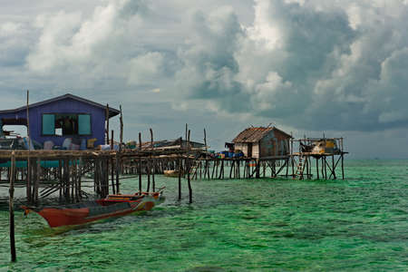 Island of Borneo. Malaysia. November 30, 2018. Sea Gypsy village on a sandy coral reef island. The main trade of local residents is fishing and sea Souvenirs. Sajtókép
