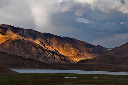 Tajikistan. Dramatic evening sky over the Pamir highway in the area of the high-altitude lake Bulunkul.