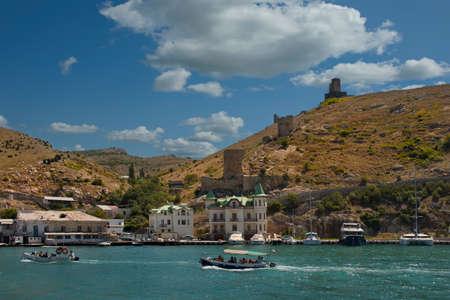 Balaclava. Russia. August 12, 2021. Tourists swim in light excursion boats along the bay of the Black Sea coast of the Crimean peninsula.
