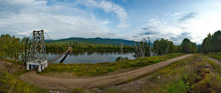 Russia. Chita region. A suspension road bridge over the Chikoy River, connecting the district center with the village of Krasny Priisk.
