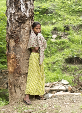 Kumbhalgard, India - July 30, 2011: Teenager standing at bank of tree, this Girl known for Garasiya community, Garasiya is a biggest community in Rajasthan n Gujrat state, this community is live in small hut at mountain and working for labour charges and
