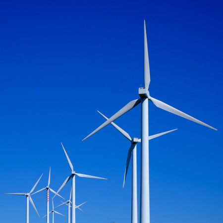 Wind turbine in a blue sky