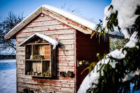 Small wooden hut in the winter background Banco de Imagens