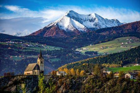 Church in front of the alps. South Tyrol Italy Europe