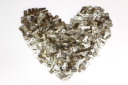 hoard: Clips are brought together to form a heart. Stock Photo