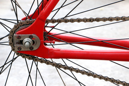 bike cover: Wheel of a bicycle chain and red Stock Photo