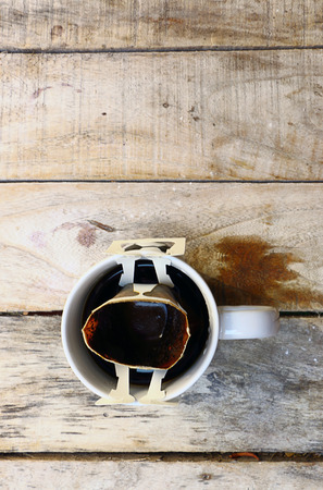 Hot coffee placed on a wooden floor in the morning. photo