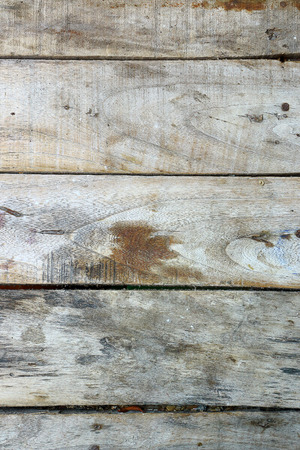 boardshorts: Old wooden planks pale arranged horizontally.