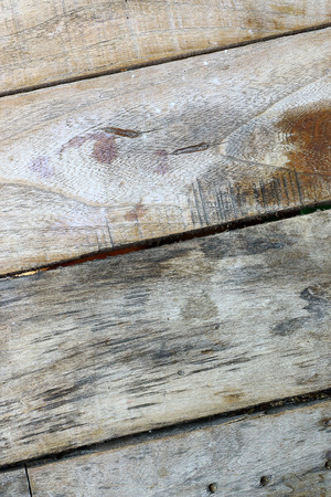 Old wooden planks pale tiles diagonally