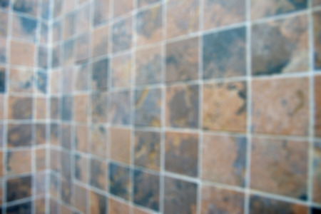 nonslip: Patterned tiles of the bathroom walls.Blurred background.