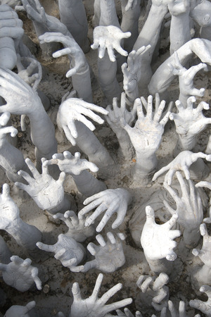 contend: Many hands reaching up to grab.