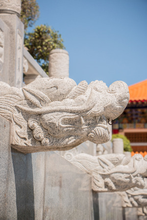 enrich: Dragon-shaped stones that adorn the walls of the walk way in a Chinese temple. Stock Photo