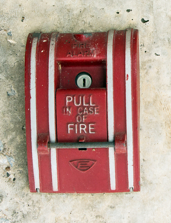 safe and sound: Fire alarm mounted on a wall in the building. Stock Photo