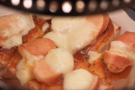 dissect: Toast homemade pizza split slices are good.Selective focus used. Stock Photo