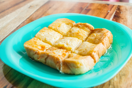 dish disk: Toast slices are great topped with honey. Stock Photo