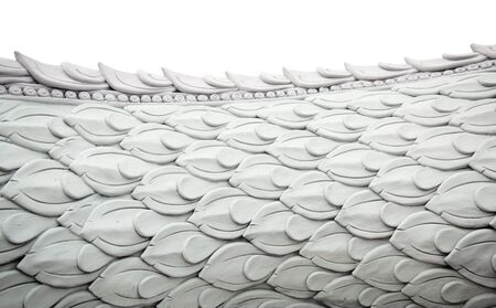 Naga stucco sculpture on the side, the scales are arranged horizontally, delicately horizontally. Diecut & Clipping Paths.
