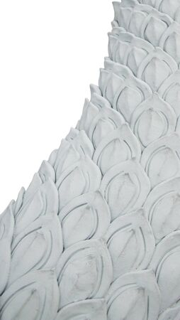 Naga stucco sculpture on the side, the scales are arranged in a delicately oriented oblique direction.Diecut & Clipping Paths.