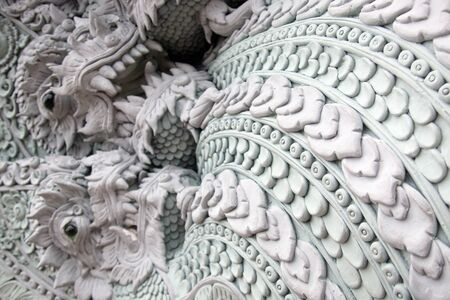 The Naga stucco sculpture is open to look formidable and exquisite.