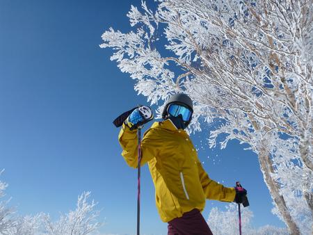 Girl skiing on a blue sky day in Nozawaonsen Nagano