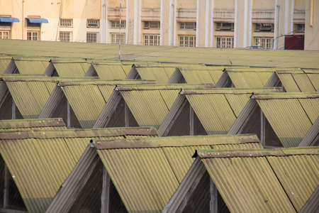 Metal roofs sheltering a train station in Myanmar Stock Photo