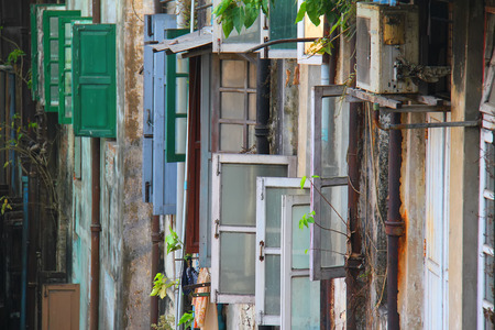 colorful windows open and closed to an alleyway in Myanmar