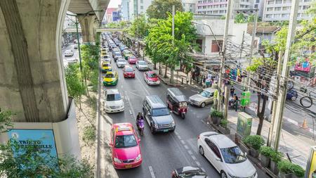 thanon: View of Traffic jams under BTS Asoke Sky train railway June 6 2015 in Bangkok.