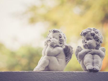 valentine cherub: Baby doll sculptures; vintage filter