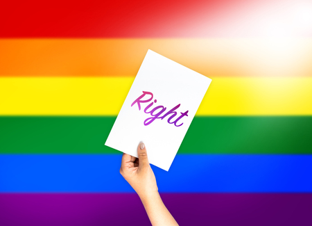 Right on card with hand holding; LGBT color flag background Stock Photo