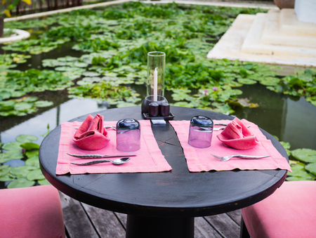 Table setup at restaurant with lotus park