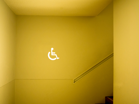 Disabled sign in building