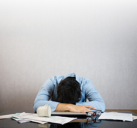 Fall asleep on work desk, stress and study hard concept