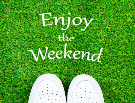 Enjoy the weekend on grass field with white sneaker, holiday and vacation background concept