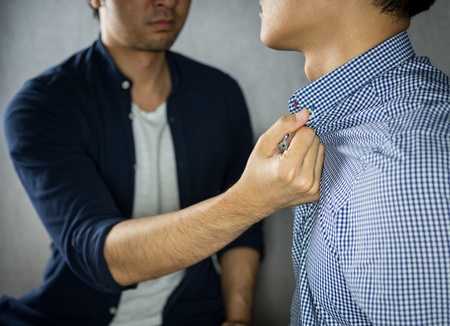 Man grab other by the collar, having argument