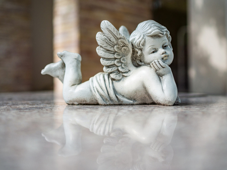 Vintage filter on Cupid sculpture close up