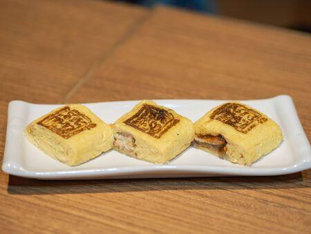 Umaki Japanese Eel Rolled Omelette on plate