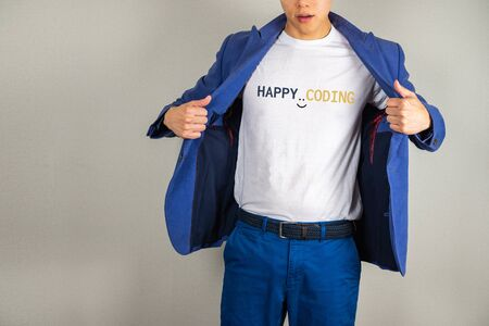 Happy coding text on white t-shirt with man opening suit Imagens