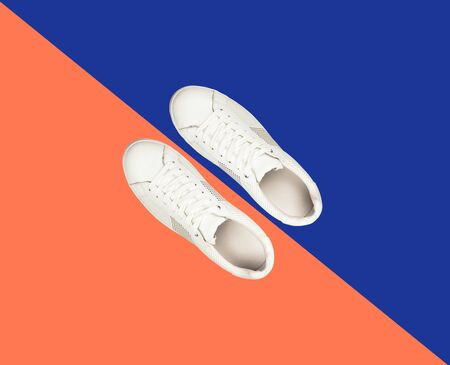 White sneaker on blue and orange color contrast background