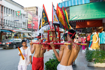 Hatyai, Songkhla, Thailand - Oct. 6, 2016 :  People celebrate a vegetarian festival during the festival ritual mortification is practised to appease the Gods.Action photography Capturing movement.