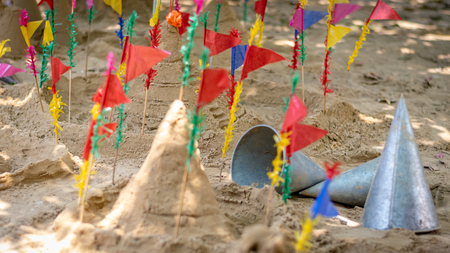 Formation sand pagoda is the oldest traditions in Songkran day festival , Thailand. (Selective focus)