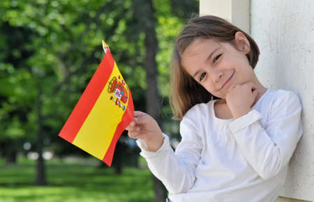 spanish: Young Girl With Spanish Flag  Stock Photo