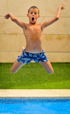 outdoor pursuit: Boy Jumping Into Pool