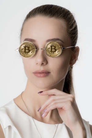 Beautiful girl in glasses from bitcoin Stock Photo