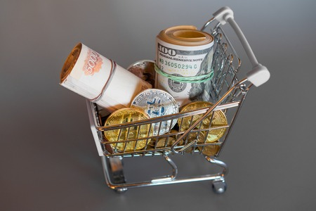 Consumer money basket Concept multi currency trolley