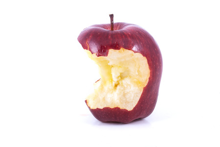 nibble: red apple bitten isolated on a white background