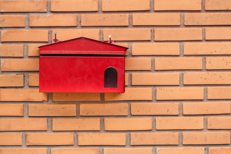 Red mailbox on a house photo