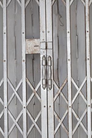 Old rusty iron shutters door photo