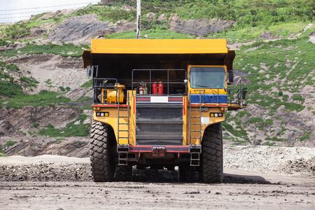 dump truck: Heavy mining dump truck driving along the opencast